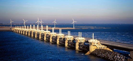 Tidal barrier and onshore wind power apparatus representing invention in renewable energy and electricity generation